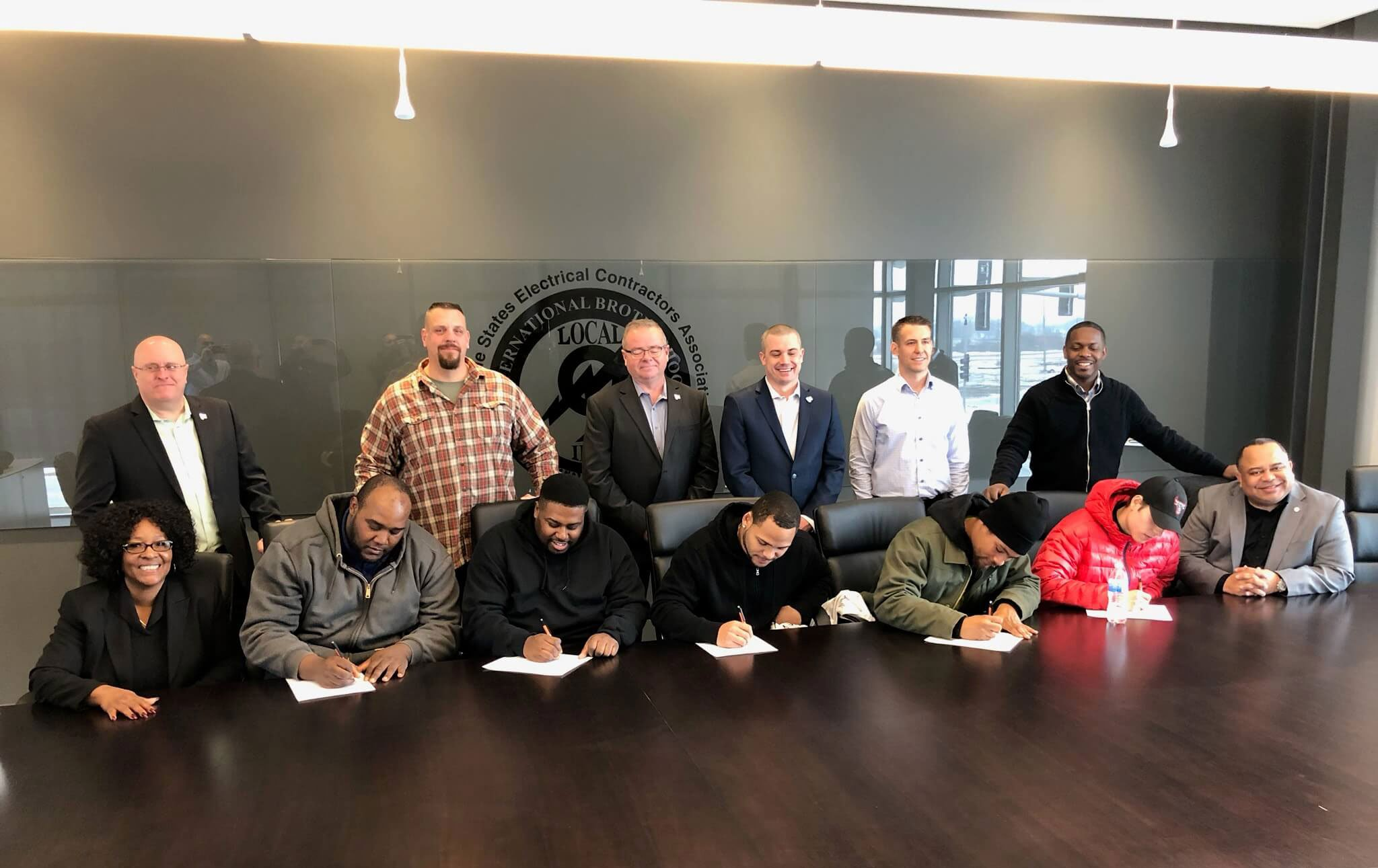 2019 Signing day with Electric Conduit Construction, Alderman Emma Mitts, Jamil Muhammad, Dr. Flavian Prince, Local 9, and five lives that will never be the same.